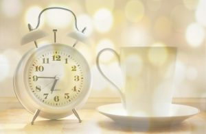 alarm clock cup of coffee